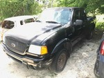 Storage Lien: Abandoned:  2002 Black Ford Ranger Pickup (1FTYR14E92PA89369)