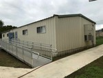 Portable Classroom/Building (to be moved at buyers expense)  Approx. 24 x 64 foot Has air conditioner/heater.  Metal siding