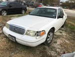 Storage Lien: Arrest:  White 2001 Ford Crown Victoria (2FAFP74W01X195149) (Odometer 100993) No keys.