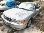 Storage Lien: Tow Away/Abandoned: Silver 2004 Kia Opt (KNAGD126045349398) No keys.