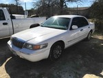 Storage Lien:  Arrest:  1999 Mercury Grand Marquis, white (VIN: 2MEFM74W3XX636654)  (mileage: 164,837)
