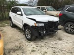 Storage Lien:  Wrecked: White 2015 Jeep Grand Cherokee (1C4RJFBG1FC609915) (approx. 49862 miles)