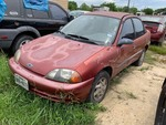 Storage Lien:  1999 Red Chevrolet Metro (2C1MR5223X6723634)