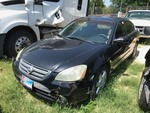 Storage Lien:  (abandoned)  2003 Nissan Altima, black, no keys, unknown condition, unknown mileage  (VIN:  1N4BL11D63C338227)