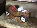 Living Room:  Solid Wood Carved Rocking Car
