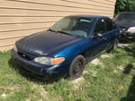 Storage Lien:  (arrest)  1999 Ford Escort, blue  (VIN:  1FAFP10P3XW136077)