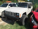 Storage Lien:  (arrest)  1999 Jeep Cherokee 4x4, automatic, 4.0 ltr, white  (VIN:  1J4FF68S4XL519511)