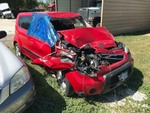Storage Lien: Wrecked, 2010 Kia Soul (red) (KNDJT2A29A7143335)